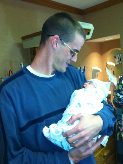 My son and his newborn first son (my first grandson to be).