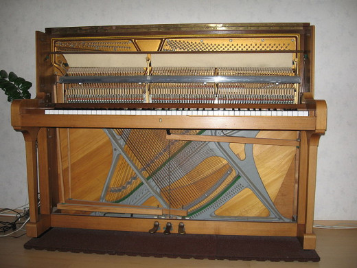 A typical upright piano with the top, bottom and keyboard covers removed.