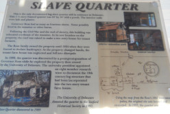 Plaque with photos of the restoration project undertaken by the Seaford Historical Society.