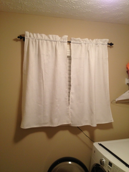 These super simple curtains were created from a recycled shower curtain after one of the grommets fell off.