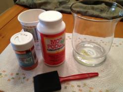 Glitter, Mod Podge, foam brush, and glass vase