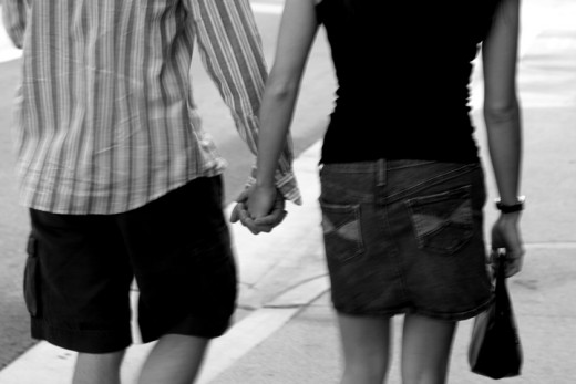 Hold her hand in public,do not let her think for one second that you are embarrased to be seen with her.