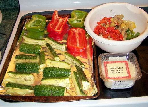 Stuffed bell peppers with Parmesan zucchini sticks on the side