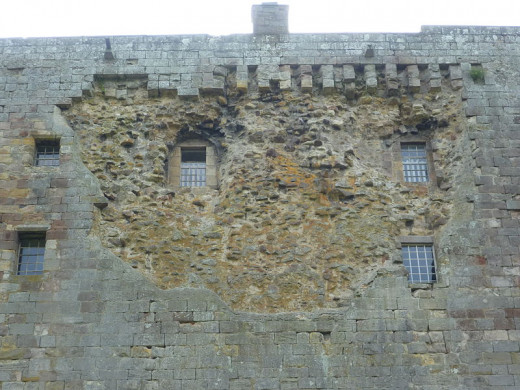 The damaged east wall of the haunted Borthwick Castle Hotel. The stone was ripped off by a cannon ball fired by Oliver Cromwell's troops