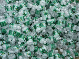 A large pile of half-pint Poland Spring bottles