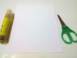 white paper, a pair of scissors
