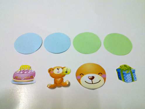 cut out the cute pictures and color paper circles
