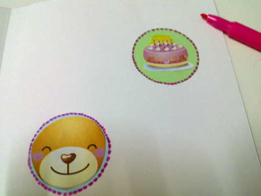 use pink marker to draw another dotted lines around the cute pictures