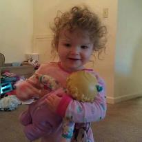 My youngest granddaughter and her lovely wild hair.  She just loves her babies.