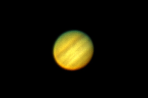 Jupiter in 2007 taken through a Celestron Afocal image.  CPC-1100 with an Olympus Camedia D-550 using an Orion Siruis Plossl eyepiece.  Multiple images stacked and processed.