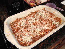 Finish the top with a layer of the meat mixture and sprinkle with 1 cup of shredded mozzarella