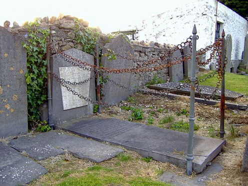 The Vampires grave, Malew, Isle of Man. Known as such for generations. The story goes that the corpse coughed during the wake and was staked through the heart!
