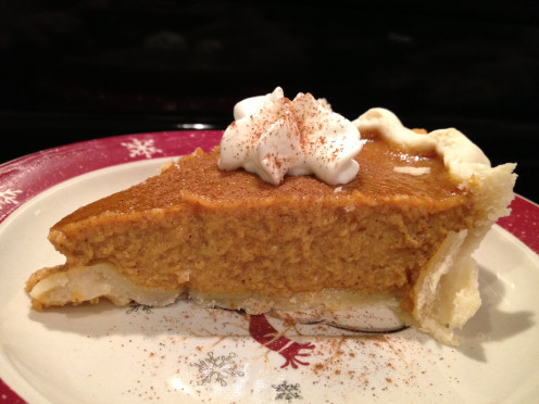 Slice of fresh pumpkin pie