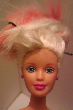 As a reminder, here's what Barbie's face looked like before her snazzy zombie makeup.