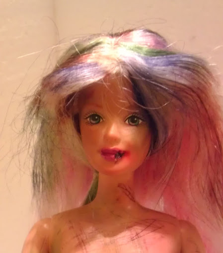 Uh oh! Barbie's lip must have gotten caught while she was chewing on something. And her new zombie 'do is perfect.
