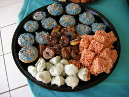 kids party platter with meringues, cupcakes, rice crispy treats and mini doughnuts