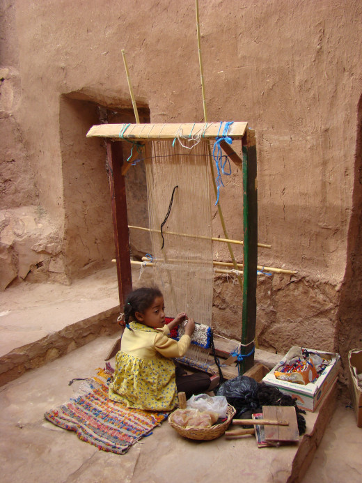 Young girl weaving in Morocco, 2008