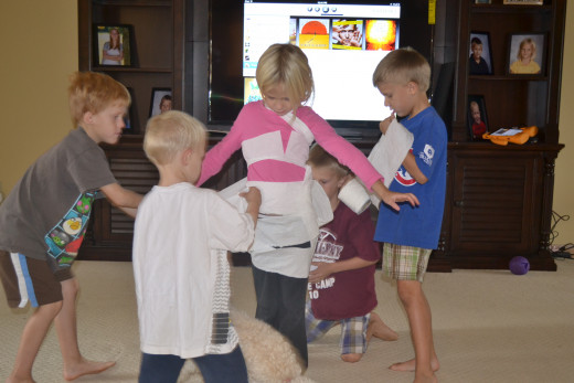 The boys had fun wrapping up their sister with toilet paper and turning her into a mummy