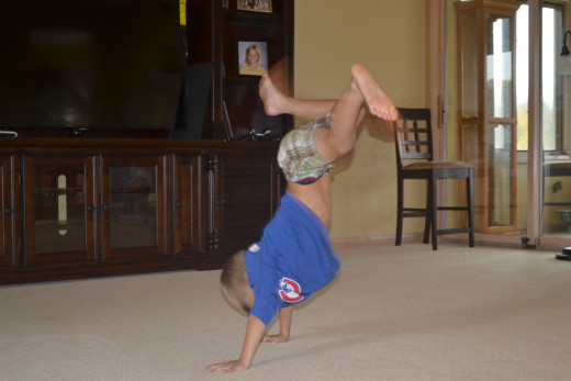 Son displaying his gymnastics skills
