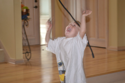 Son taking on a battle with a rope during the talent show