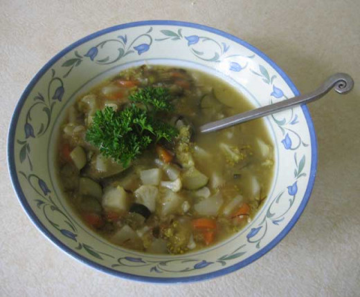 Yummy vegetable soup with pink lentil and sea vegetable.