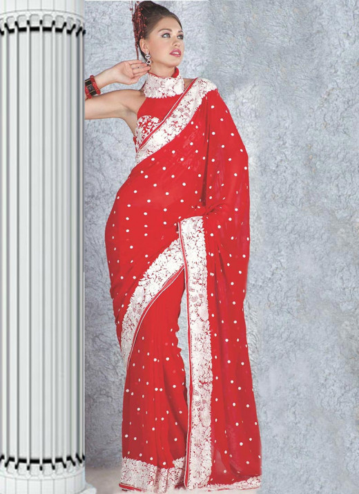 Alluring Red Resham Embroidered Saree. Photo courtesy of Cbazaar.
