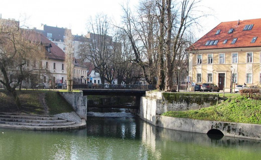 The confluence of the Gradaščica and Ljubljanica Rivers in Ljubljana, Slovenia at the Jek Bridge was photographed by Doremo on January 6, 2012.