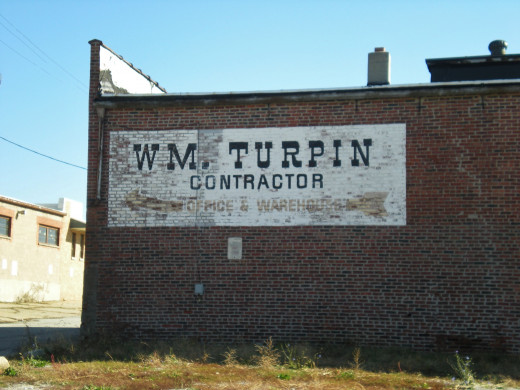 Sign for William Turpin, Contractor in the Bloomington, Illinois warehouse district.