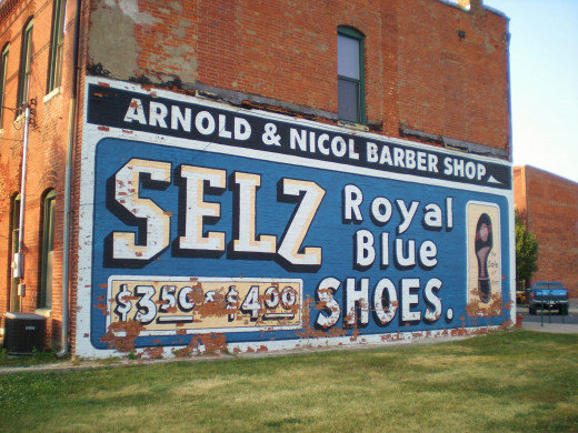 Probably faux (or repainted) ghost sign for Selz Royal Blue Shoes in Chenoa, Illinois.