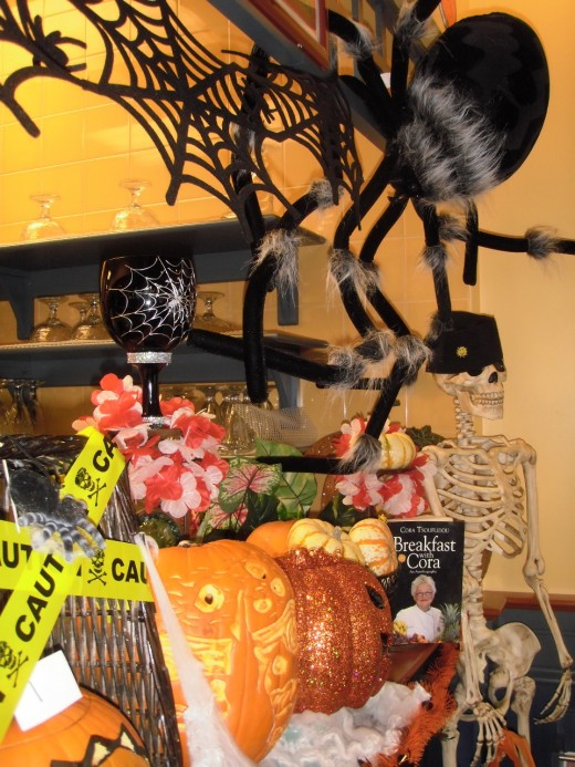 Canadians have fun decorating homes and businesses for Hallowe'en, like this spooky corner at Cora's in Kamloops, British Columbia.  Children there for Saturday brunch with their family chuckle and shriek as they pretend to be the scariest Tarantula.
