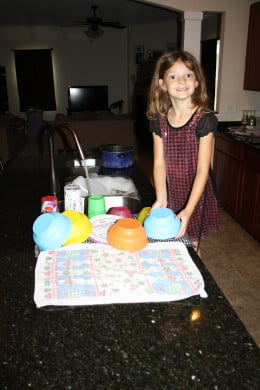 My littlest girl helping with dishes.