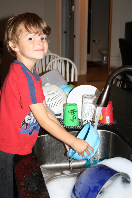 My boy helping with dishes.