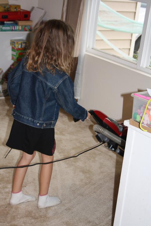 My little girl taking her turn vacuuming.