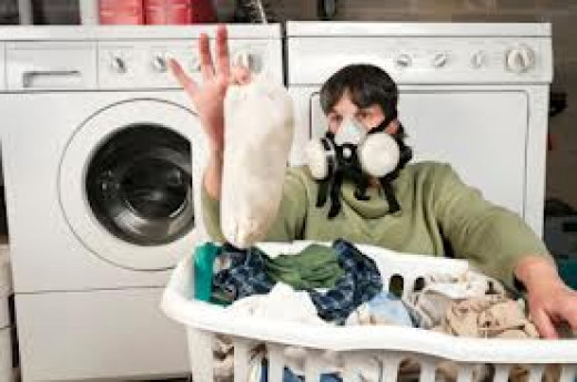 Wear protective gear when handling fabric stained with mildew and mold. This protects against breathing in mold spores if they become airborne. A mask and rubber gloves will do the trick.