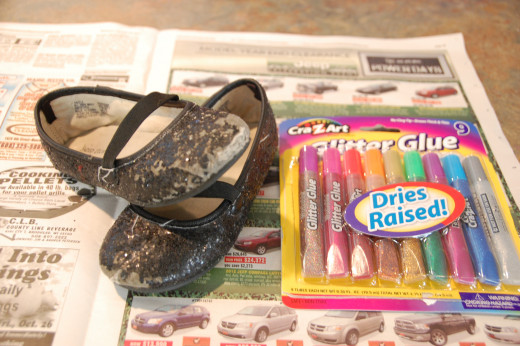 Pick the color of glitter glue that works best with your pair of shoes