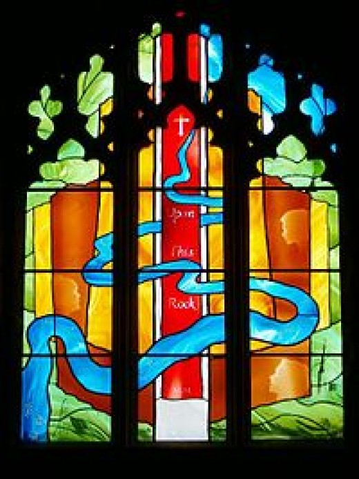 Goodrich Castle Chapel window with medieval glass.