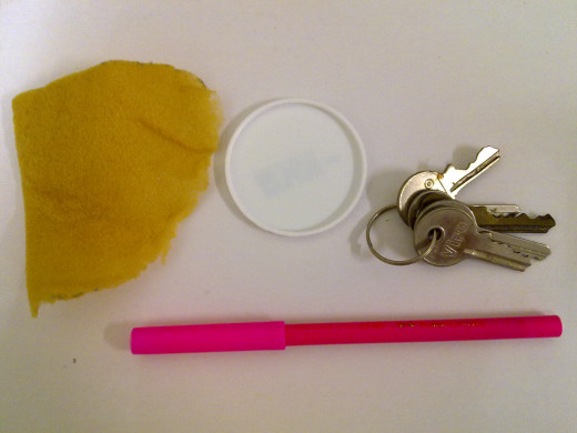 thin sponge, a circle lid, keys to test, marker pen