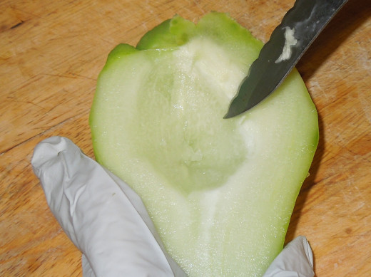 Remove the core of a chayote squash