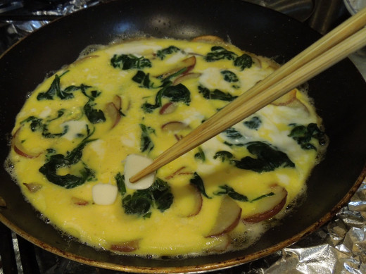 Adding string cheese to egg frittata