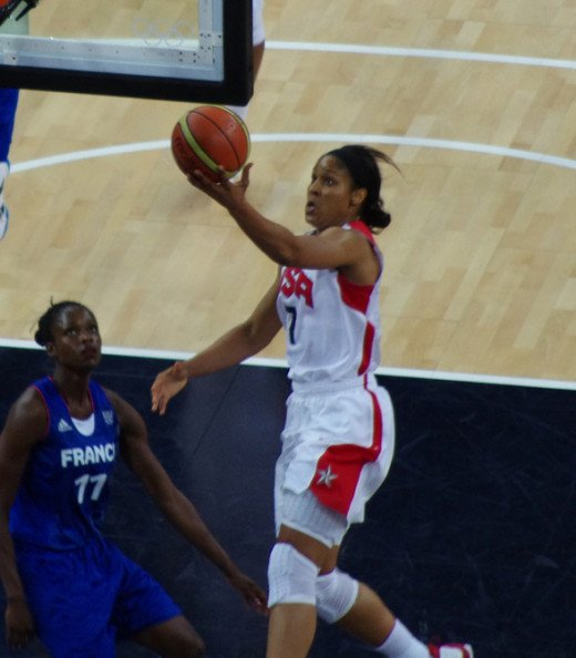 American cager Maya Moore heading for an unassailable lay-up against a Frenchwoman defender.