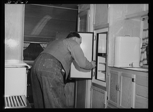 A man tearing out the guts of his refrigerator