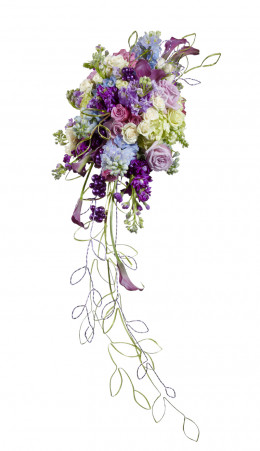 The trails on this cascade bouquet are almost entirely made from wide metallic wire, giving this bouquet a thoroughly 21st century look. These are fresh flowers, but there is no reason you couldn't do the same with silk.