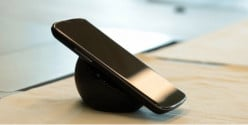 Google's LG Nexus 4 being charged wirelessly on it's wireless charging station