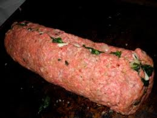 Roll up the meat into a jelly roll or log.  Slice before or after cooking.