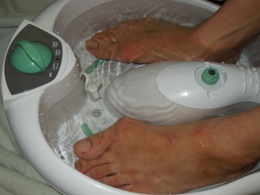 Soaking feet in warm water