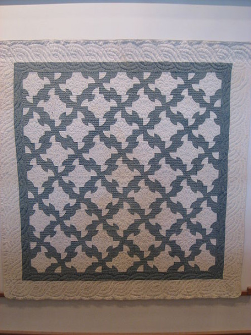 "Traditional pattern known as ""Drunkard's Path"", completed in 1900 by unknown Amish crafters. Exhibited in the Charles Hotel, Cambridge, Massachusetts."