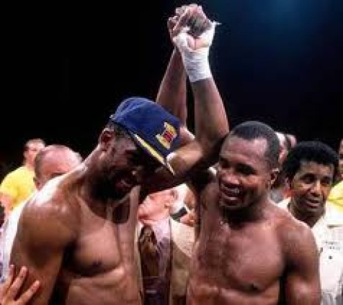 Sugar Ray Leonard raises Tommy Hearns hand in controversial draw. The pair fought twice with Leonard winning once and the two boxing to a draw in the rematch.