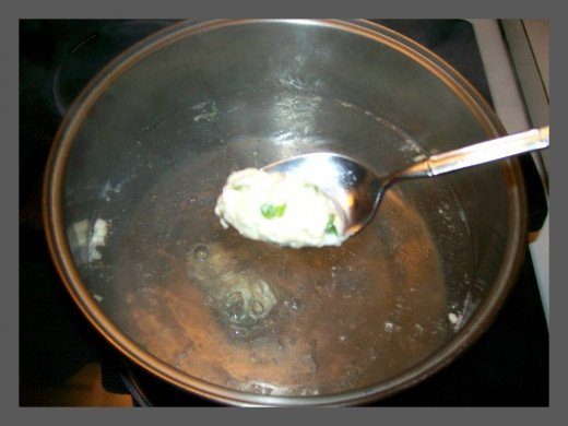 Once water is heated to a rapid boil, begin dropping dumplings.  Source:  Sharyn's Slant