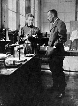 Marie and Pierre Curie working together in the lab.