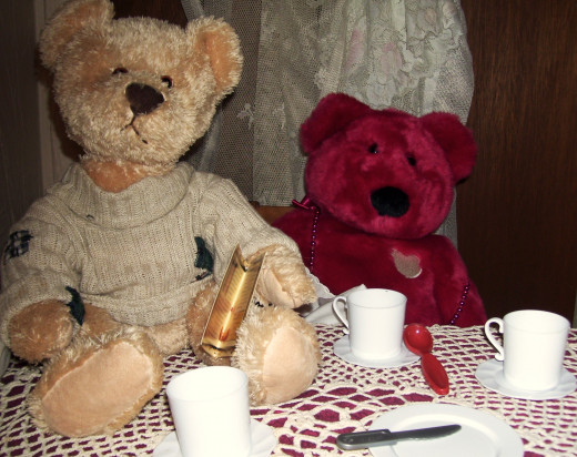 At an informal tea, it is acceptable for a short bear to sit on the table. As long as his feet are clean.